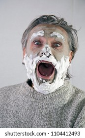 Mature man  under beauty mask screaming loudly