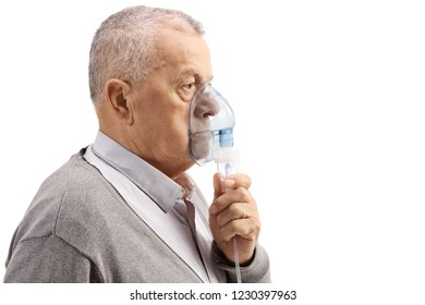 Mature man using an inhaler isolated on white background