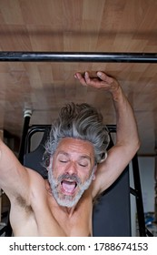 Mature man using inversion table at  home