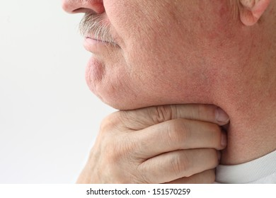 mature man with a very sore throat