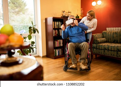 Mature man in wheelchair playing race game with VR headset