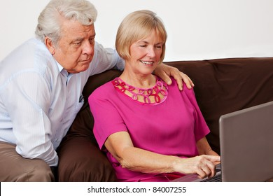 Mature man and wife working on computer.
