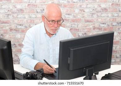 mature man working on his graphics tablet