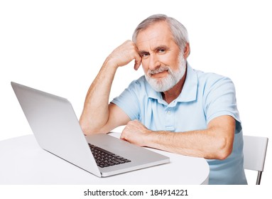 Mature man working on laptop, isolated on white
