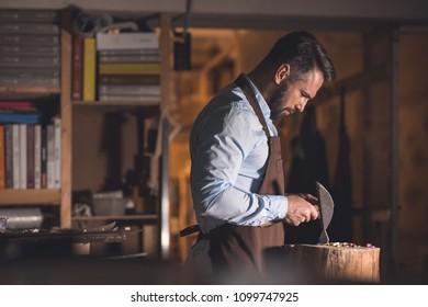 Mature master at work in workshop