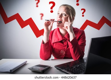 Mature, middle aged woman having questions about money and finance. Business woman in red clothes worried about her income, paycheck and credit. How to invest your capital concept.
