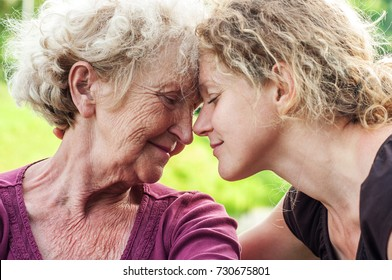 Mature mother and daughter face to face