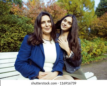mature mother with daughter outside
