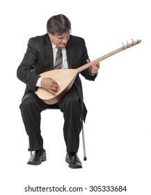 Mature musician man playing reed