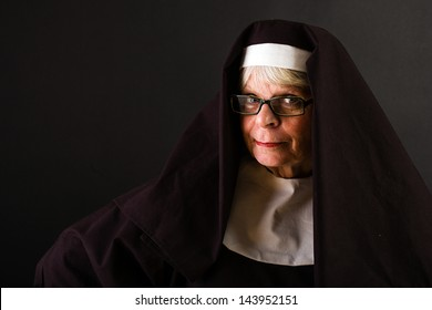 A mature nun with a friendly face