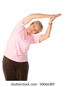 Mature older lady in yoga position, isolated on white background