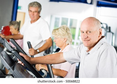 Mature older man exercising in the gym