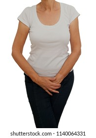 Mature, older woman holdig crotch. Discomfort from incontinence, menopause or similar personal problem. On white background.