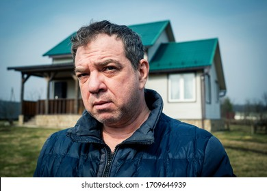 Mature pensive man outdoors portrait