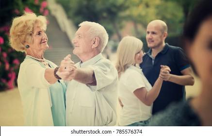 mature people dancing tango in outdoor