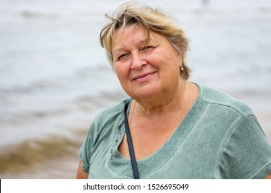Mature plump woman resting on the beach of the Baltic sea