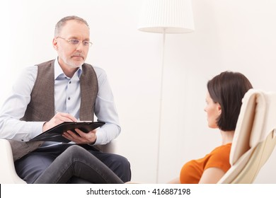 Mature psychologist is giving advice to patient