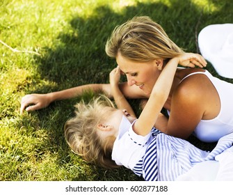 mature real mother with daughter outside in park, recreation concept, lifestyle people