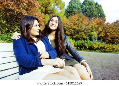 mature real mother with daughter outside autumn fall in park