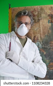 mature restorer posing in studio with green background