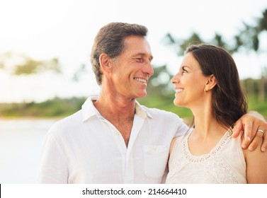 Mature Retired Couple Enjoying Tropical Sunset Beach Vacation
