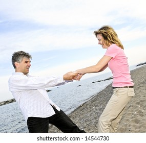 Mature romantic couple having fun on a beach