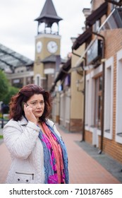 Mature sad woman talking on a mobile phone in the city, problems among middle-aged women. Sad news, women's depression and bad mood