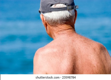 Mature senior grandfather pensioner looking at the future and taking a sun bath