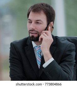 Mature smiling confident business man talking on the phone
