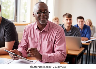 Mature Student Using Digital Tablet In Adult Education Class