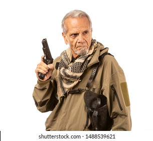 Mature survivalist with a gun drawn, looking to the right.