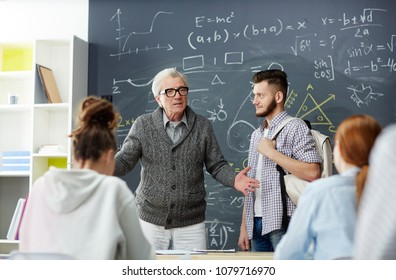 friendly teacher talking his students lesson stock photo edit now