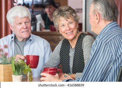 Mature trio of friends in a coffee house