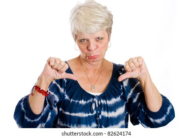 Mature white haired woman showing her unhappiness with two thumbs down.