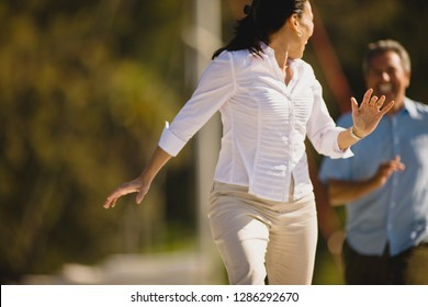 Mature woman being chased by her husband