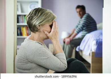 Mature woman with black eye is victim of domestic violence and abuse.