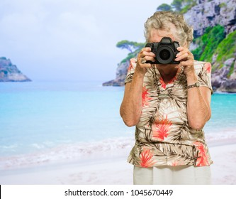 Mature Woman Capturing Photo, Outdoors