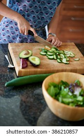 Mature woman chopping vegetables