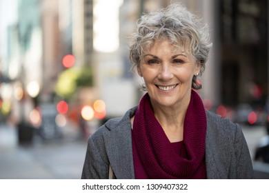 Mature woman in city smile happy face portrait