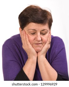 Mature woman with close eyes on a white background