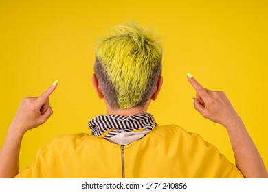 mature woman with colored stylish yellow dyed hair and red lipstic lips in warm dress background studio copy spase.forever young soul.