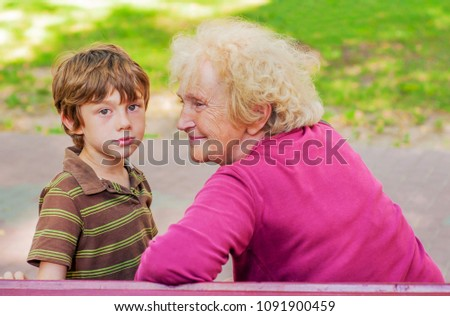 Mature woman and boy