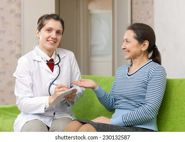 mature woman complaining to friendly doctor about feels
