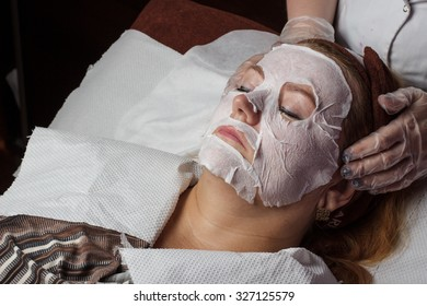 Mature woman with cosmetologist