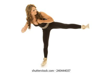 A mature woman doing a kick to the side.