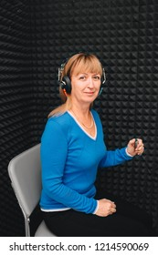 mature woman during audiometry, hearing test at audiologist office