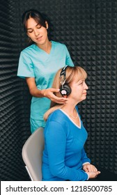 mature woman during the hearing exam in the audiologist's office. audiogram, ear exam