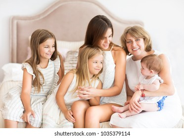 Mature woman embrace with little girl. Grandmother and granddaughters. Family and love concept