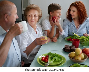 mature woman with family dinner at table, home, parents, children and grandparents, happy smile lunch