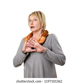 Mature woman frightened protecting by hands isolated on white background